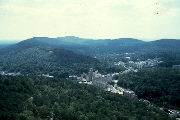Photo of downtown valley flanked by the forested Hot Springs Mountain, West Mountain and Sugarloaf Mountain, taken from the Hot Springs Mountain Tower