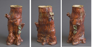 Three views of a ceramic sculpture of a the lower part of a tree trunk with a medium reddish-brown glaze on the outside and a light brown, almost cream, glaze in the inside. There are tree branch stubs on two sides of the trunk and some green leaves grouped on opposite sides.