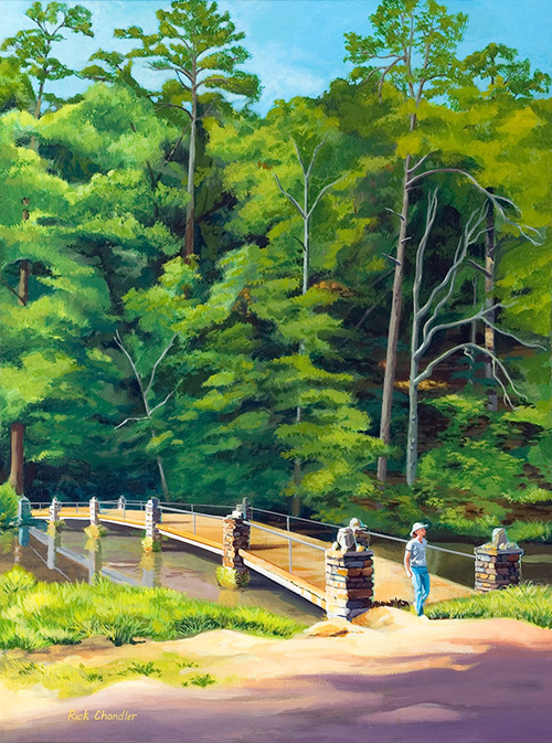 Vertical painting of Stonebridge with trees in the background on the far side of the bridge and a woman standing at the near end of the bridge facing as if she just walked across it; foreground is bare with shadows.