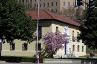 Adminstration building, taken from southwest corner from across the street. The saucer magnolia on that corner of the building is in bloom.