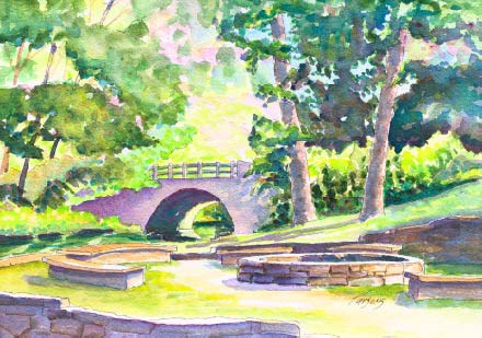 watercolor painting showing rock fire ring in right foreground with arc-shaped rock benches on the left; center of picture is a bridge flanked by trees