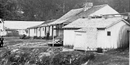 black and white photo of Rector's bathhouse, a small one story frame building near the edge of Hot Springs Creek