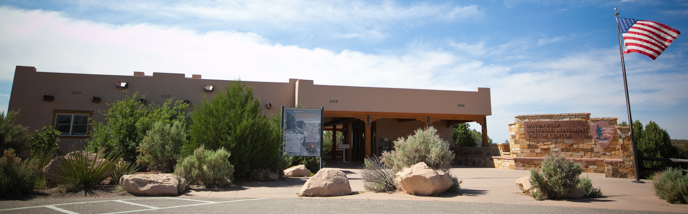 A visitor center with American flag flying outside.