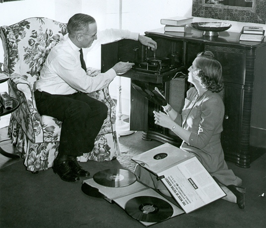 Senator Truman and his daughter Margaret listen to music in their Washington D.C. home, April 1942