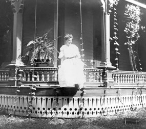 Bess Wallace sits on porch of her Independence home, circa 1905.