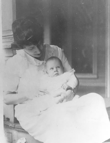 Bess Truman holding infant Margaret on porch of Truman Home, 1924. Harry S. Truman Libary, #83-10.