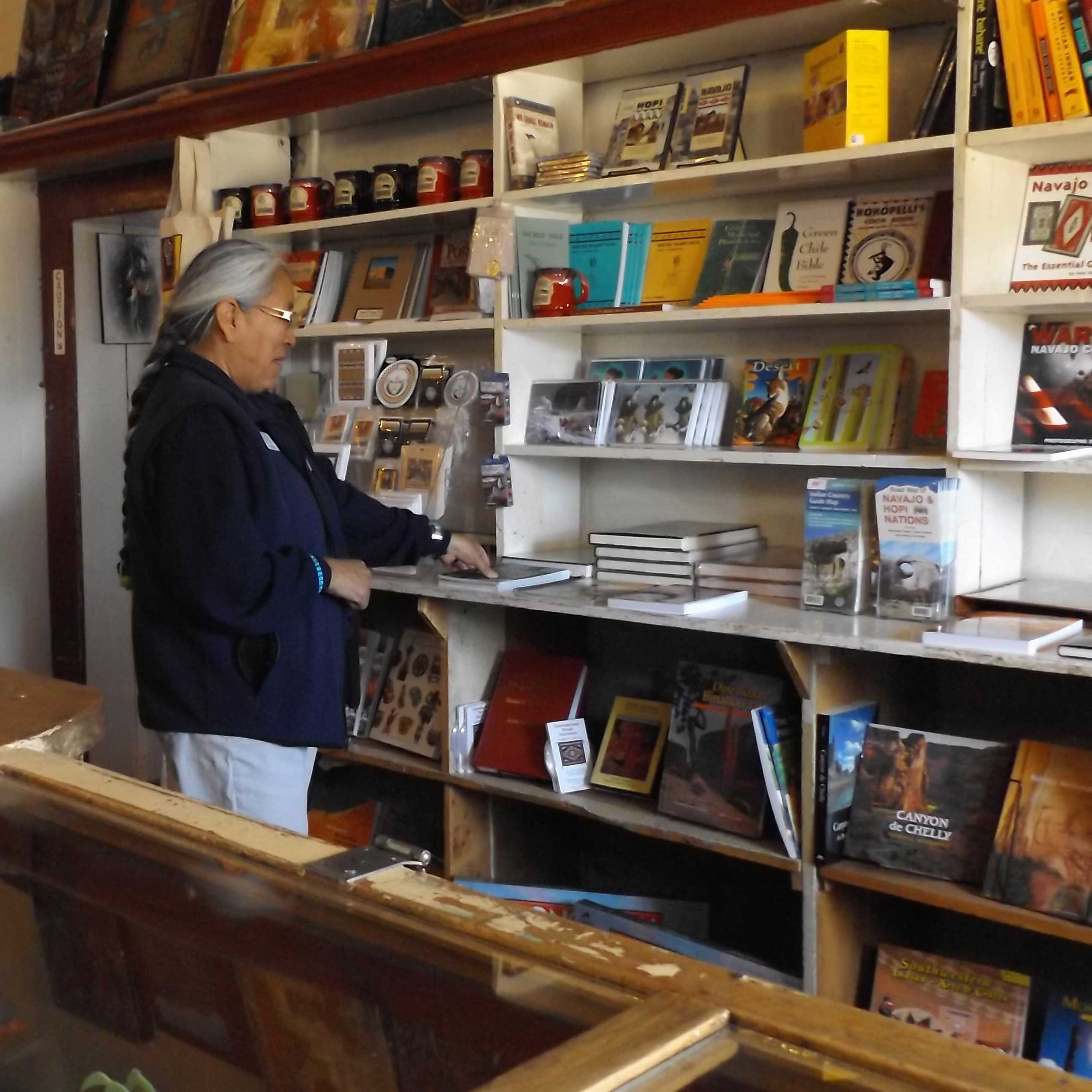 Park Store manager inspects new books