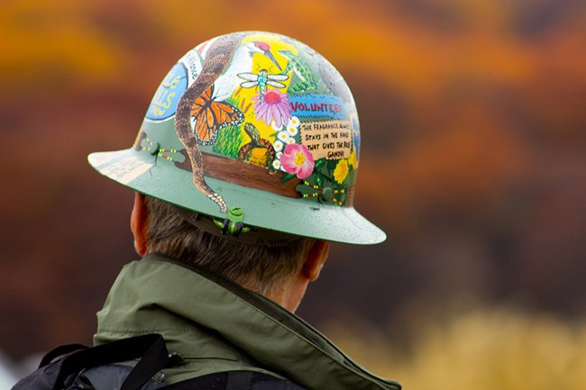A Trail Volunteer wears a hard hat