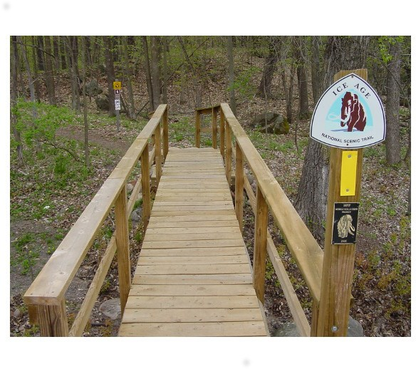Ice Age Trail markers and bridge along Blueberry Segment.