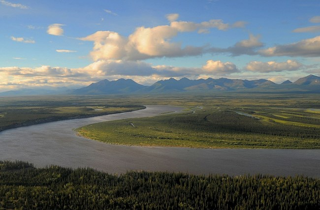 The Kobuk River meandering with the Brooks Range in the background.