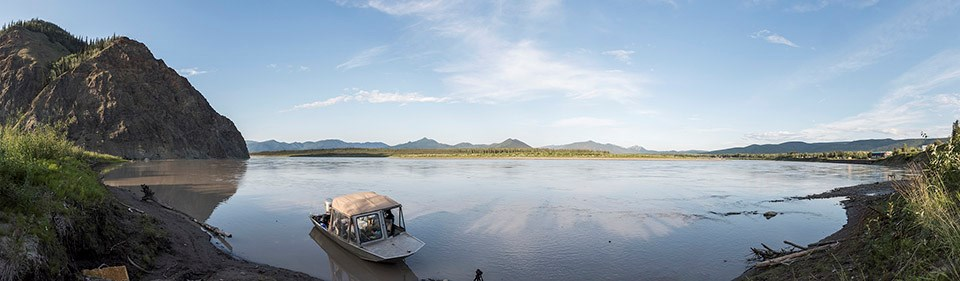 A panoramic image of the Yukon River and an NPS research boat.