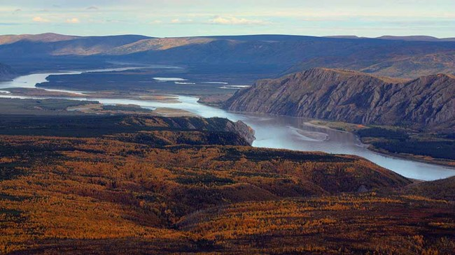 An aerial image of the Yukon River showing the rocky cliffs and uplands.