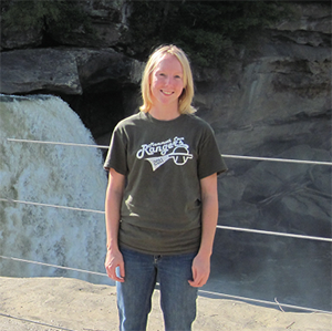 Clare Bledsoe standing in front of waterfal