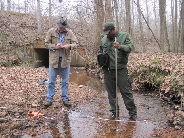 Cumberland Piedmont Network hydrologist Joe Meiman and natural resources specialist Marcus Johnson conduct stream discharge measurements at Shiloh National Military Park.