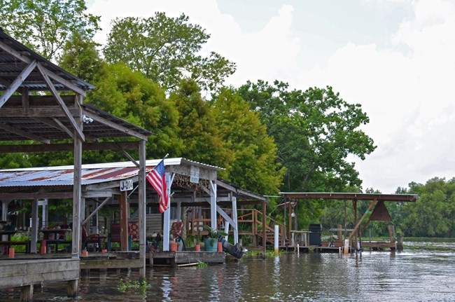Wooden docks and camps along a canal bordering Jean Lafitte NHP&P