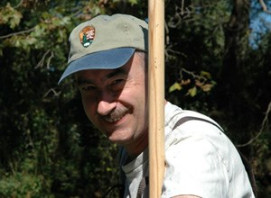 David Bowles in the field wearing an NPS cap