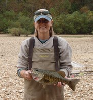 Hope Dodd holding a fish during field work