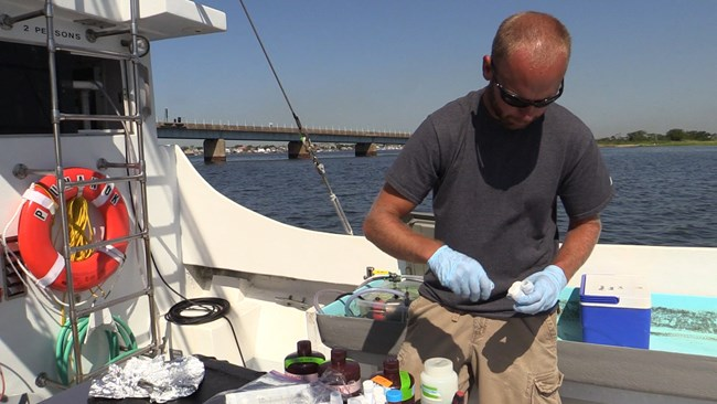 collecting water quality sample at Jamaica Bay, Gateway National Recreation Area
