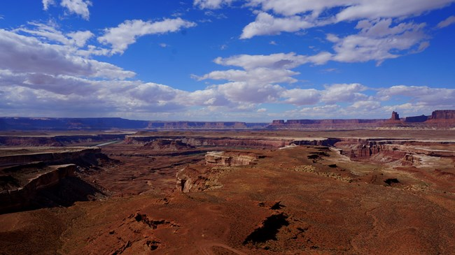 Vast canyon landscape and bright blue sky