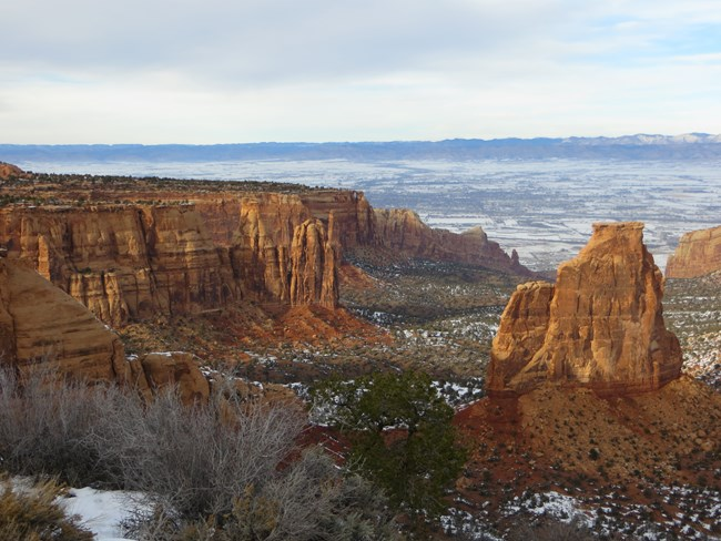 Red rock canyons with open, flat landscape beyond