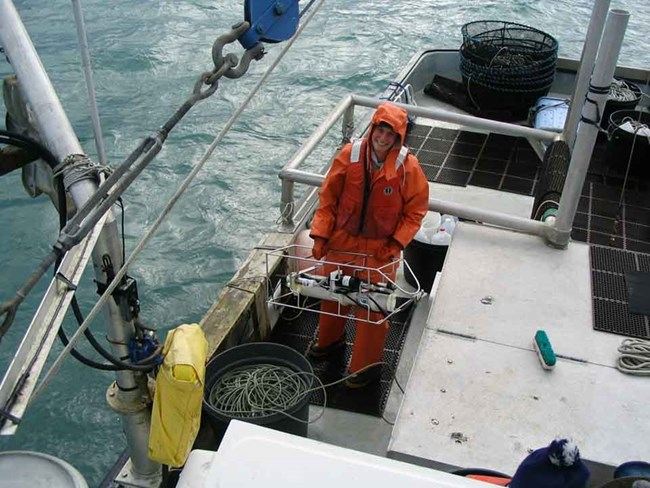 A researcher prepares instruments to collect ocean water chemistry.