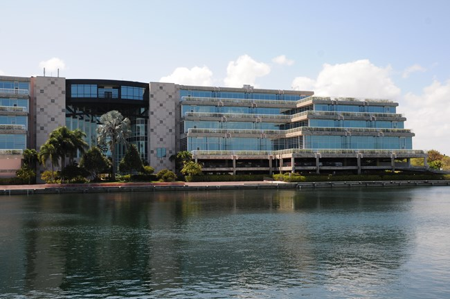 The South Florida/Caribbean Network main office building next to a lake