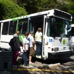Photo of visitors boarding the Muir Woods Shuttle/Marin Transit Route 66. The Muir Woods Shuttle brings passengers within steps of the entrance on weekends and holidays, only in the summer.