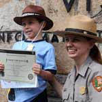 A proud, new Junior Ranger is sworn in.