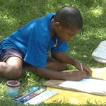 A young visitor enjoys painting with watercolors.