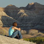 Female visitor enjoys solitude in the badlands photo by Larry McAfee