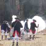 Reenactors firing the 3-pounder