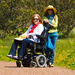 Visitor using a wheelchair on the Tennessee Valley Trail.