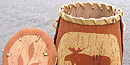A Passamaquoddy birchbark basket with the image of a moose on it