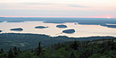From atop Cadillac Mountain, the sun is just starting to rise over the Porcupine Islands.