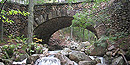 Cobblestone Bridge, faced with rounded cobblestones, has a stream running underneath.