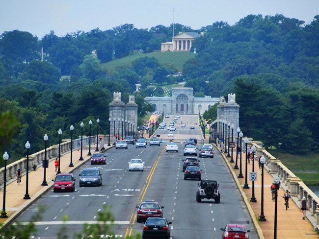 A view of Arlington Memorial Bridge looking towards Arlington Cemetary with the Robert E. Lee house at the top of the hill