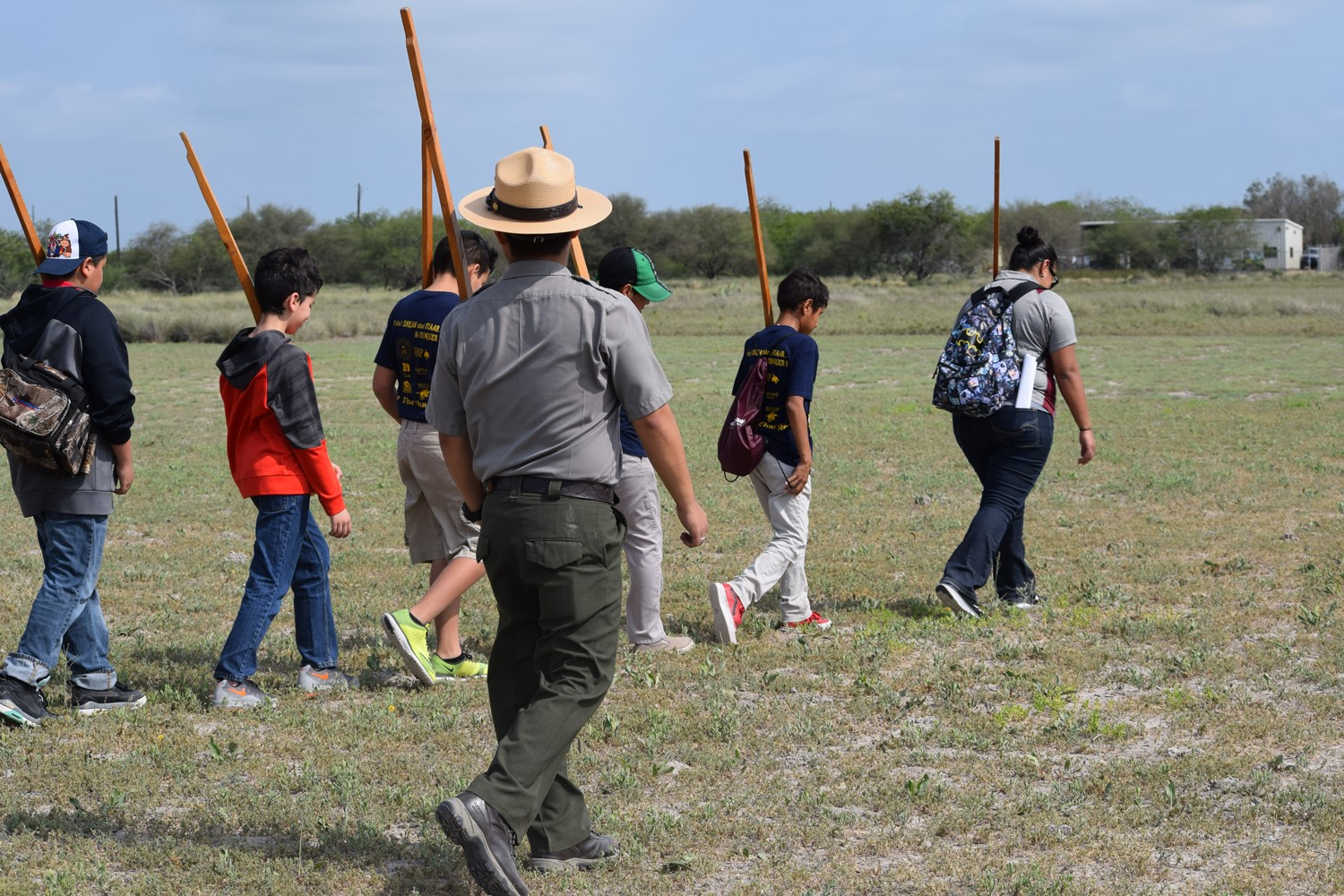 Students are doing infantry drills with wooden muskets