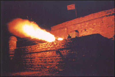 Fort Matanzas firing a cannon at night