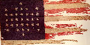 A portion of the 33-star United States flag, also known as the Fort Sumter garrison flag