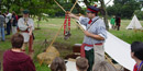 A park Guide presents a program at the Brigade Encampment special event