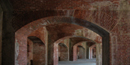 The arches at Fort Massachusetts are made of red and tan bricks.