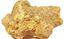 chunk of solid gold, the surface irregular and bumpy