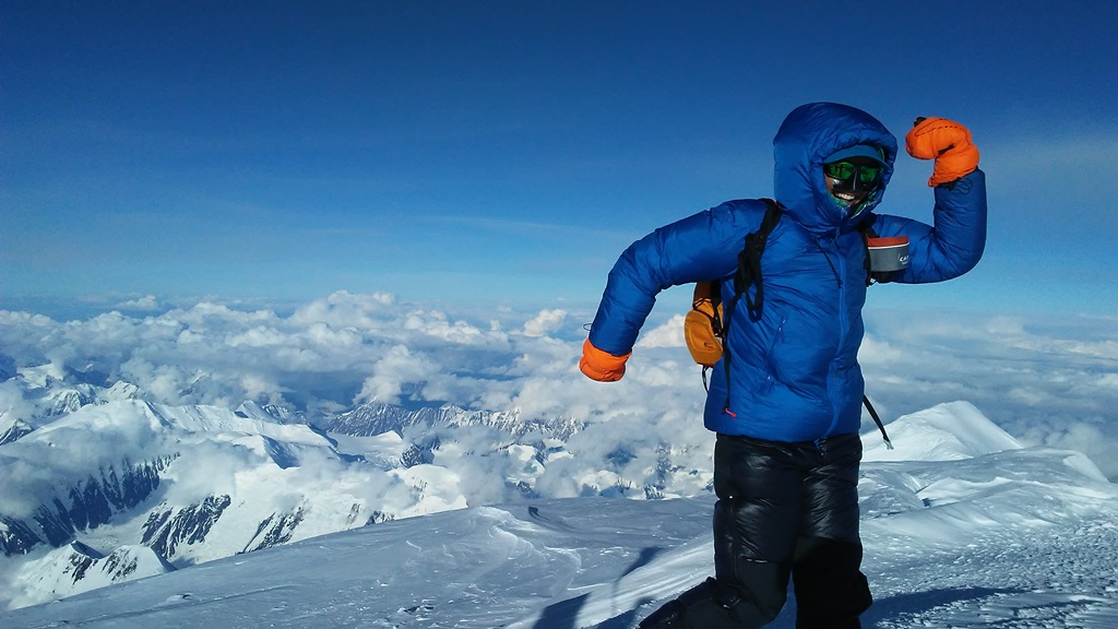 Climber Katie Bono enjoys a cold, but gratifying moment  on the summit after her speed ascent.