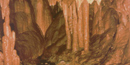 Stalactites and stalagmites in a cave at Ozark Riverways.
