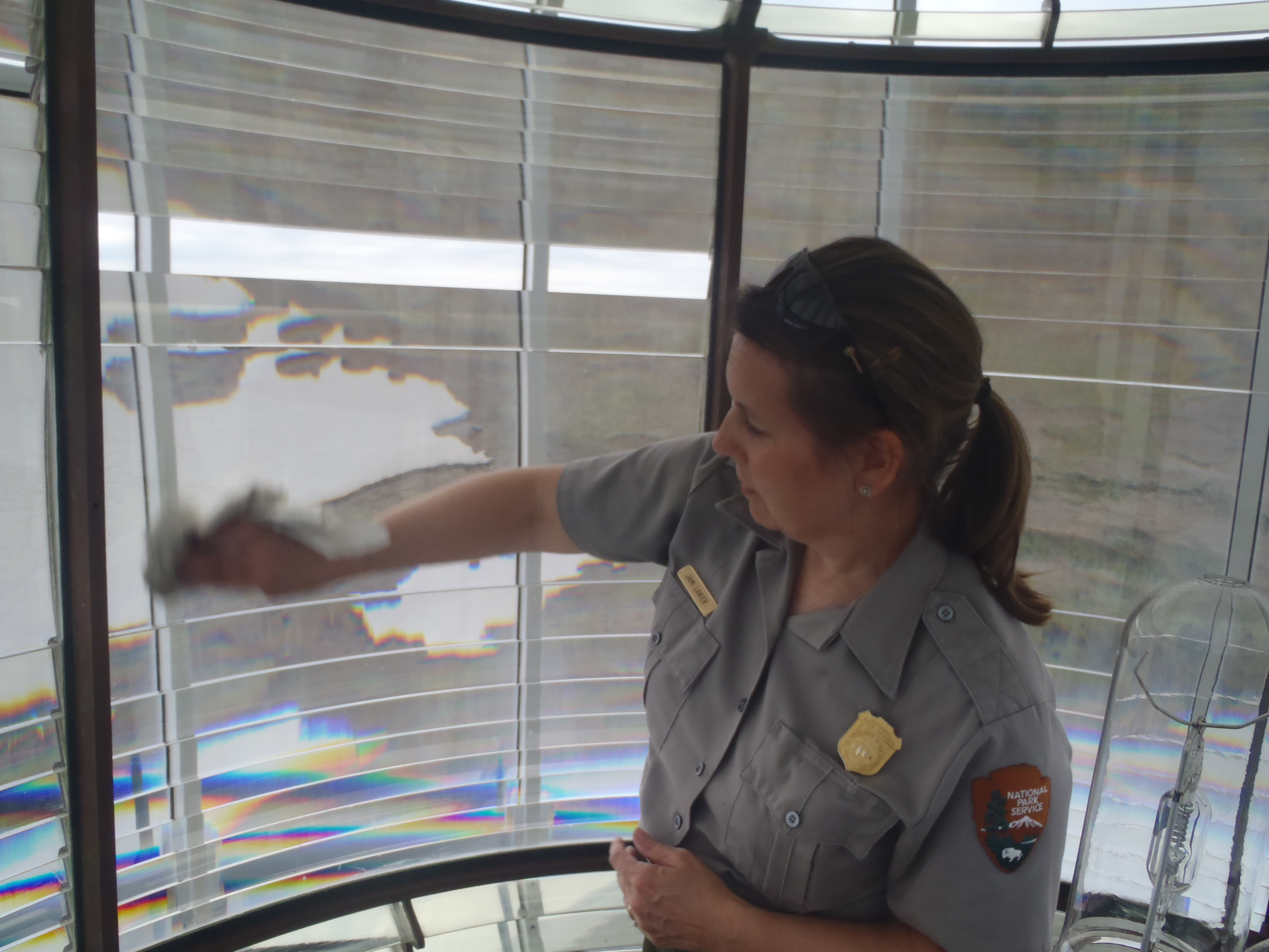 Jami Lanier cleaning Bodie Island Fresnel lens