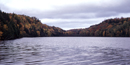 Chapel Lake is shown with fall colors, a beautifu view of the northwoods in Pictured Rocks National Lakeshore.
