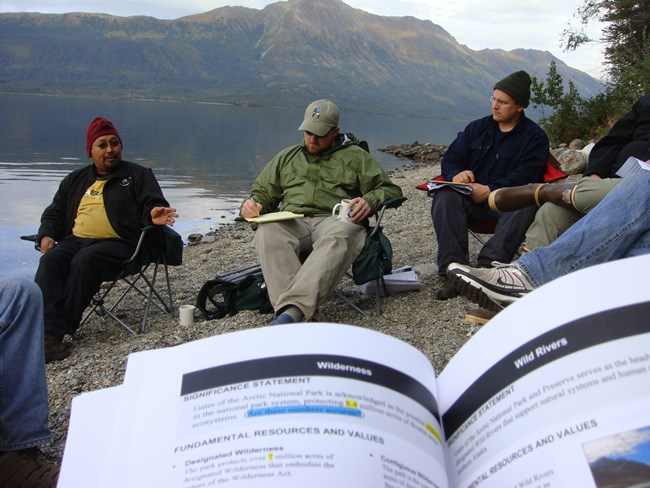 Park staff discuss planning considerations in the Gates of the Arctic Wilderness.