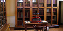 The tall glass fronted bookcase in the Customs House once held leather bound volumes.