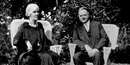 Herbert and Lou Henry Hoover sitting on the porch of the Brown House at Rapidan Camp in Shenandoah National Park.