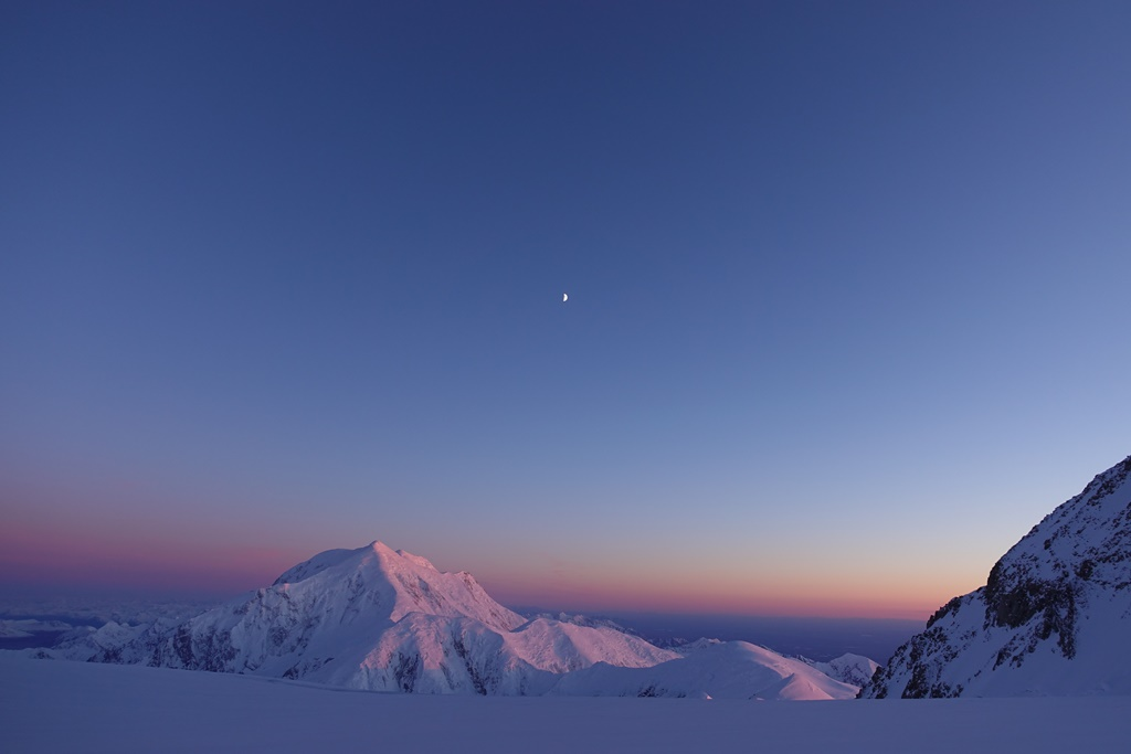 The sun sets and moon rises over Mount Foraker